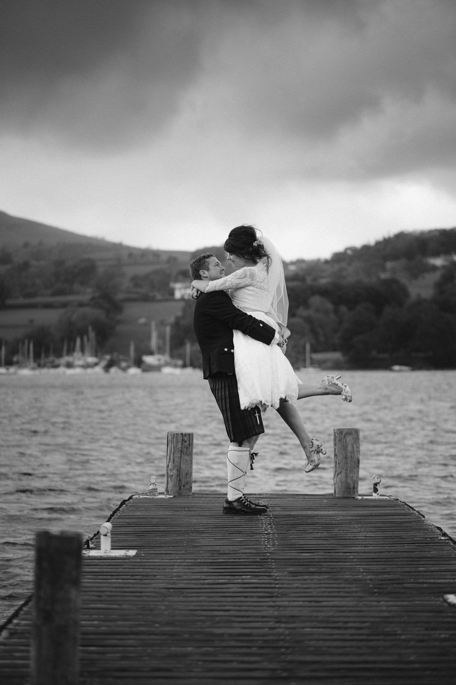 Bride Lifted up by Groom by Waters edge at Tipi Wedding On The Shores Of Ullswater