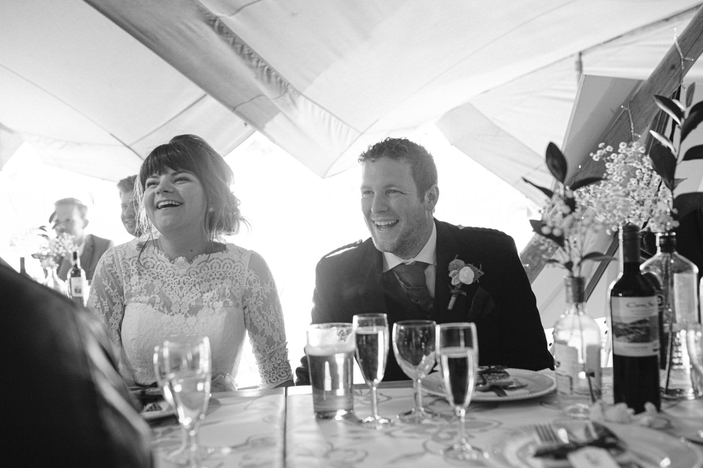 Charlotte and Jack Smiling at Tipi Table Wedding Venue