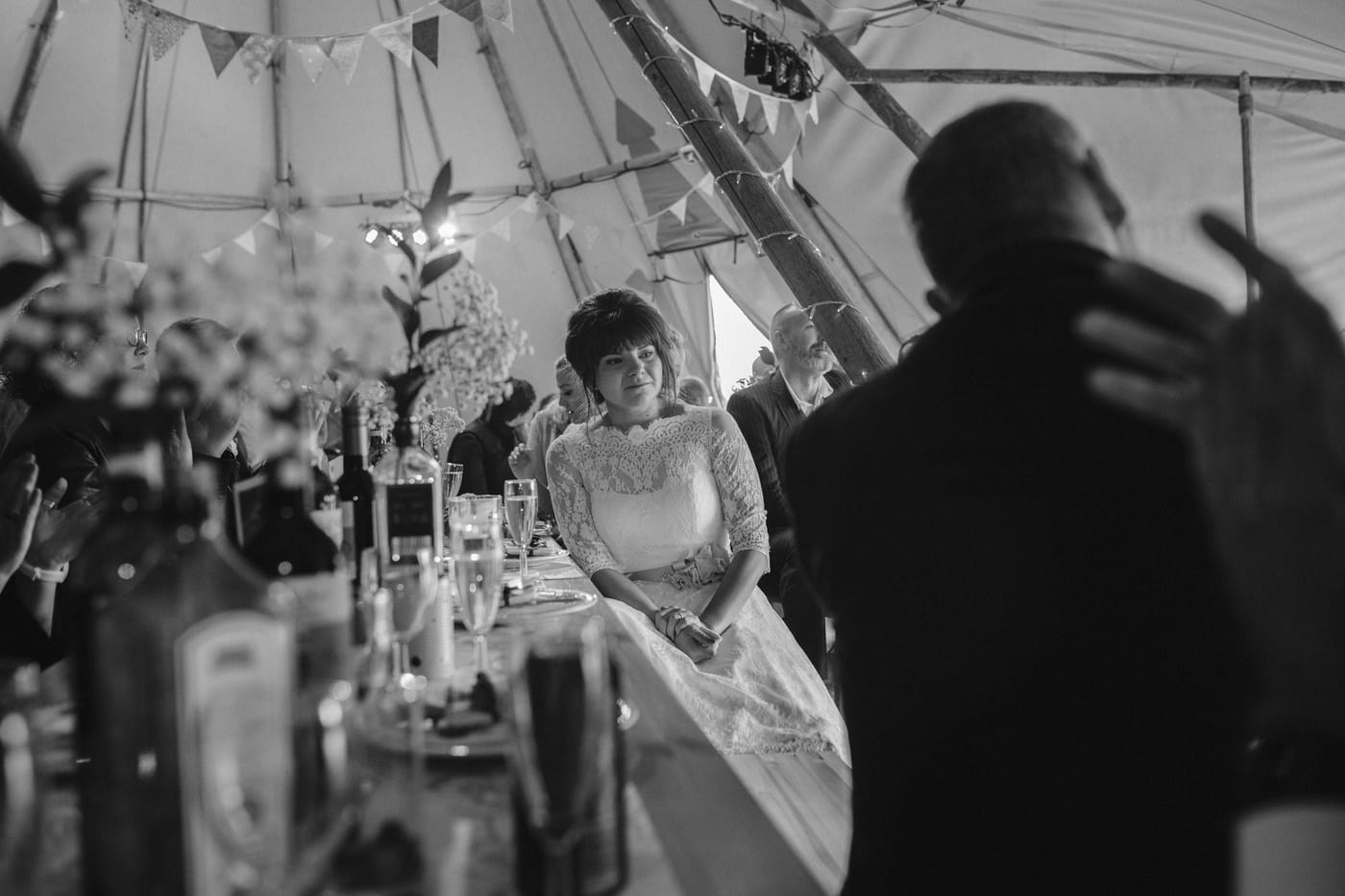 Single Portrait of Bride Under Tipi Tent Wedding Venue