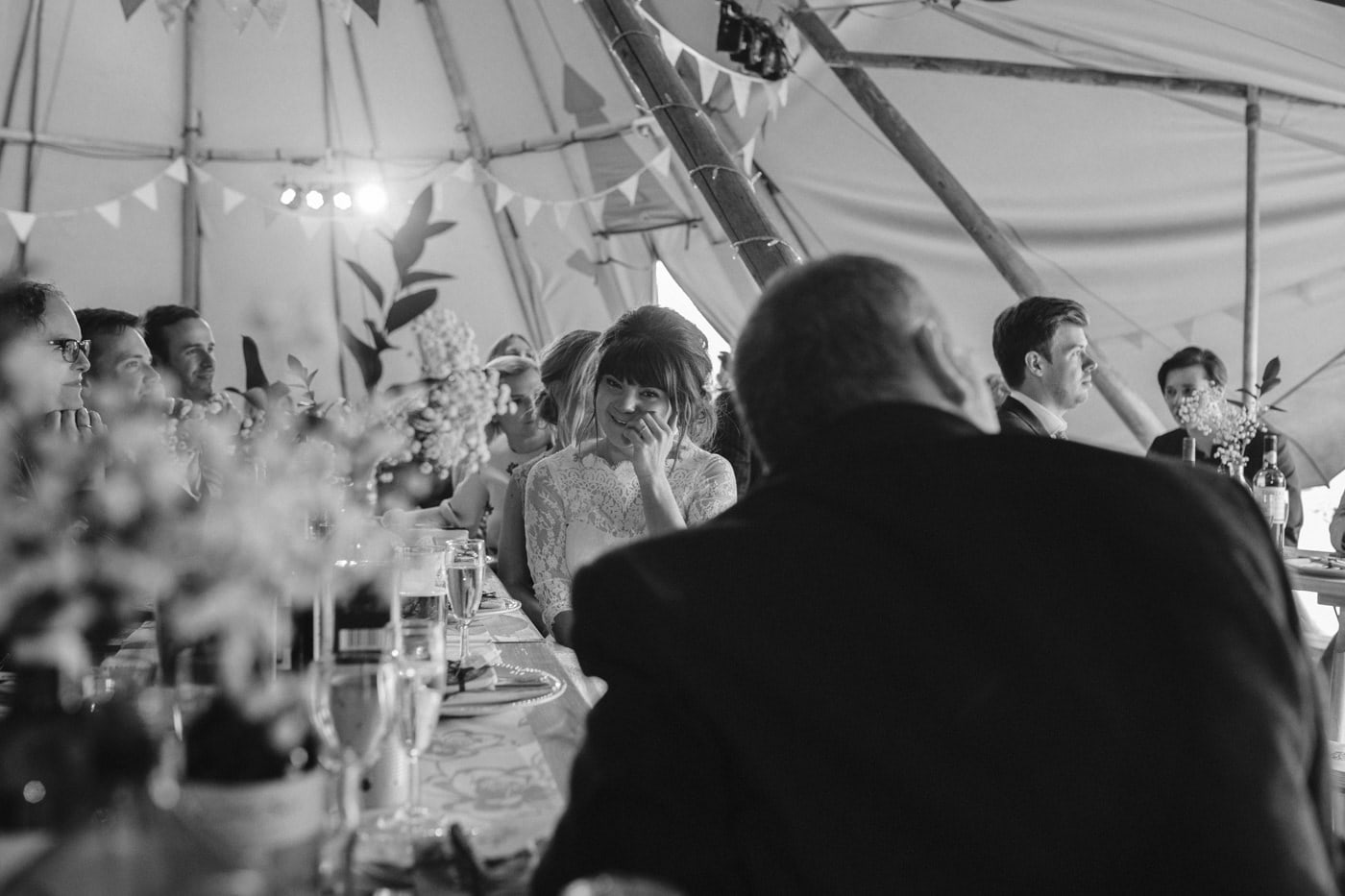 Portrait of Bride and Guests Under Tipi Tent Wedding Venue