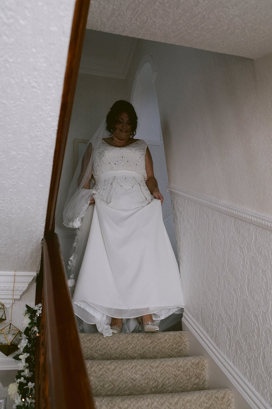 Bride Walking Down the Stairs at Irton Hall Photography