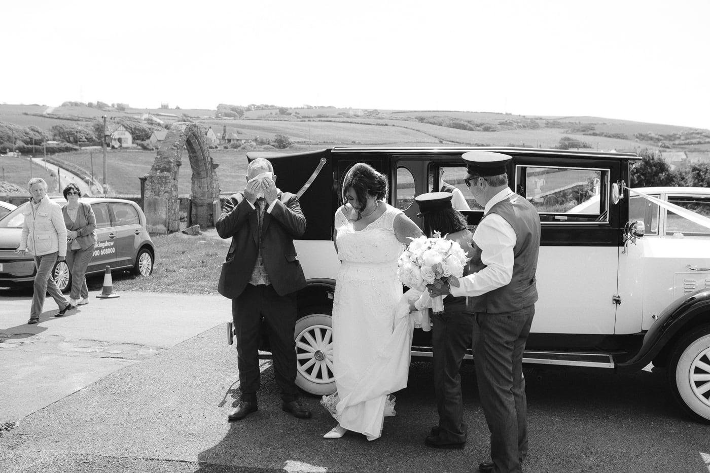 Bride in Wedding Dress Outside Wedding Car Ready For Big Day at Irton Hall Cumbria