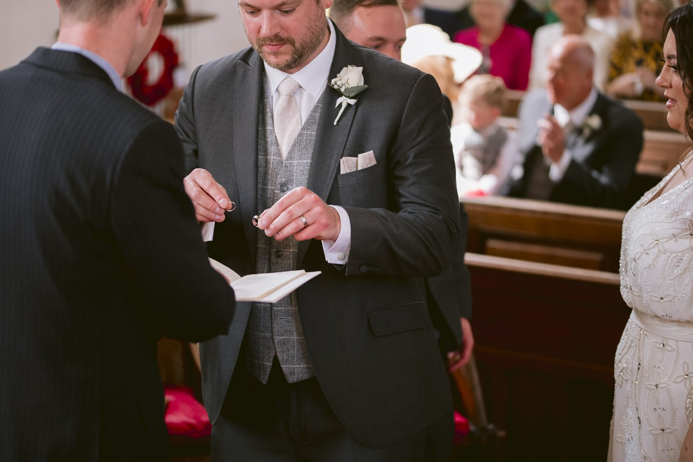 Groom Placing Wedding Rings with Minister Portrait Shooting