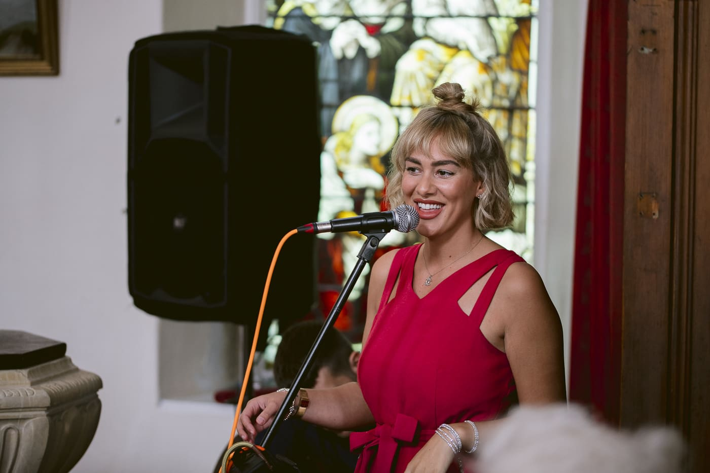 Red Dress woman Singing for Guests at Irton Hall Cumbria