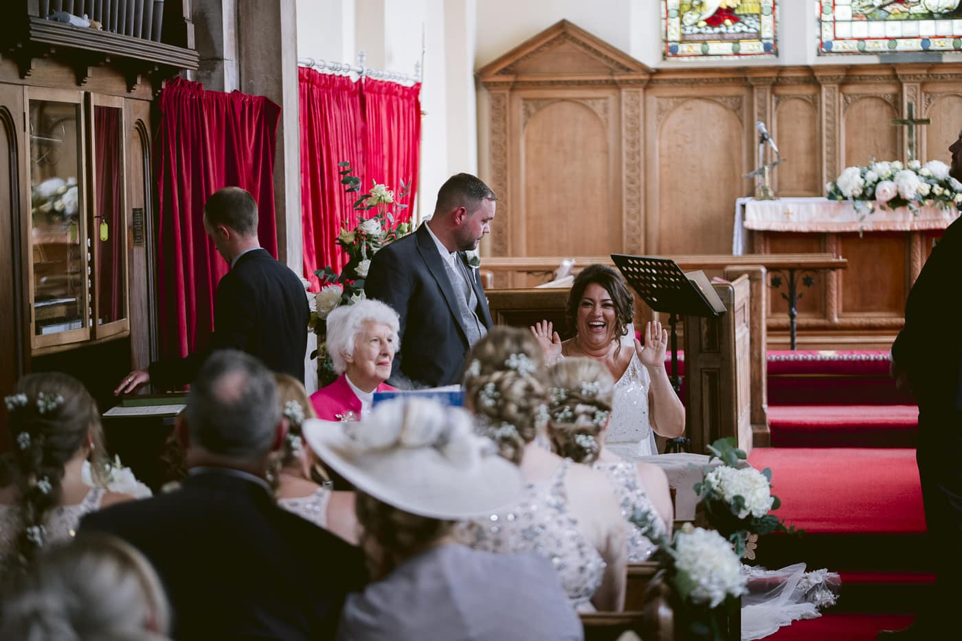Bride and Groom With Wedding Guests in the Main Hall Photography Portrait