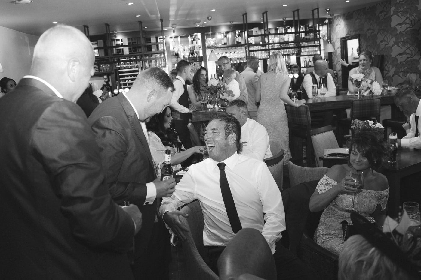 Guests having fun at the Bar Photograph Session