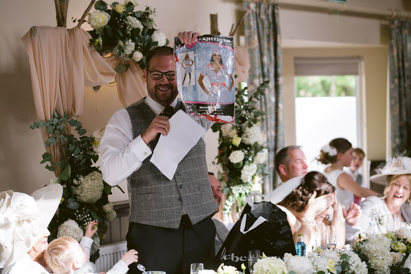 Man in Wedding Suit Giving Speech to Guests Photography