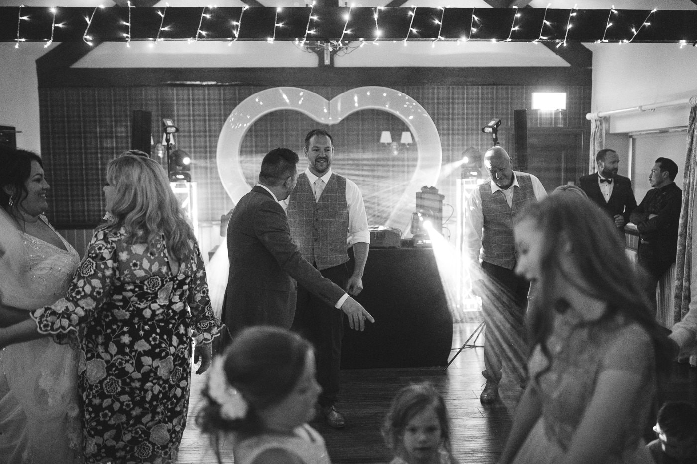 Groom and Best Man with Heart shape in background on the Dance Floor Photography Session