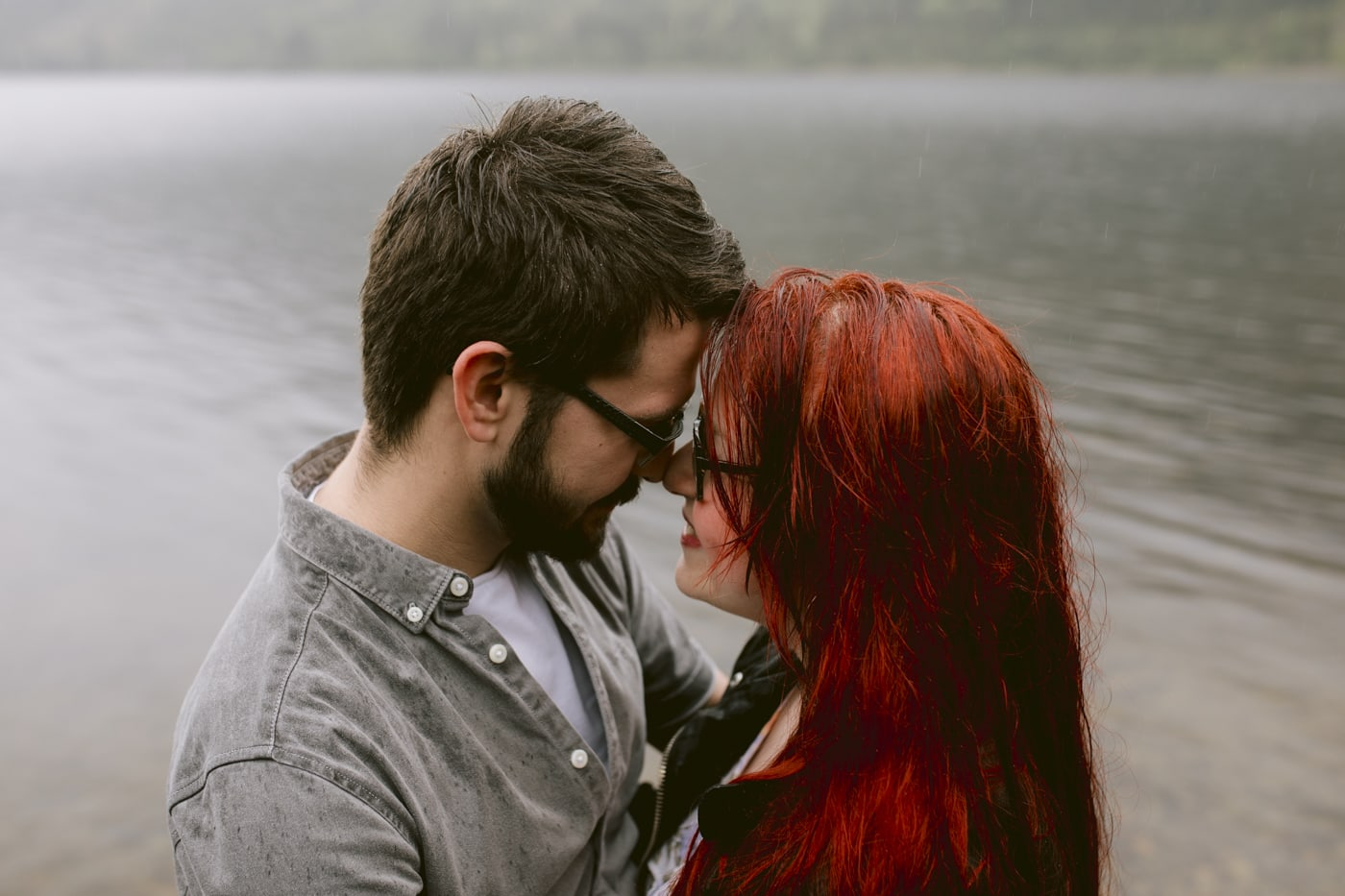 Couple Gazing into Each Others Eyes by the Lakeside Portrait Session