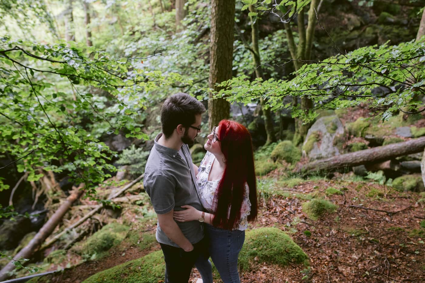 Couple Portrait Session Embraced in Arms in the Forest
