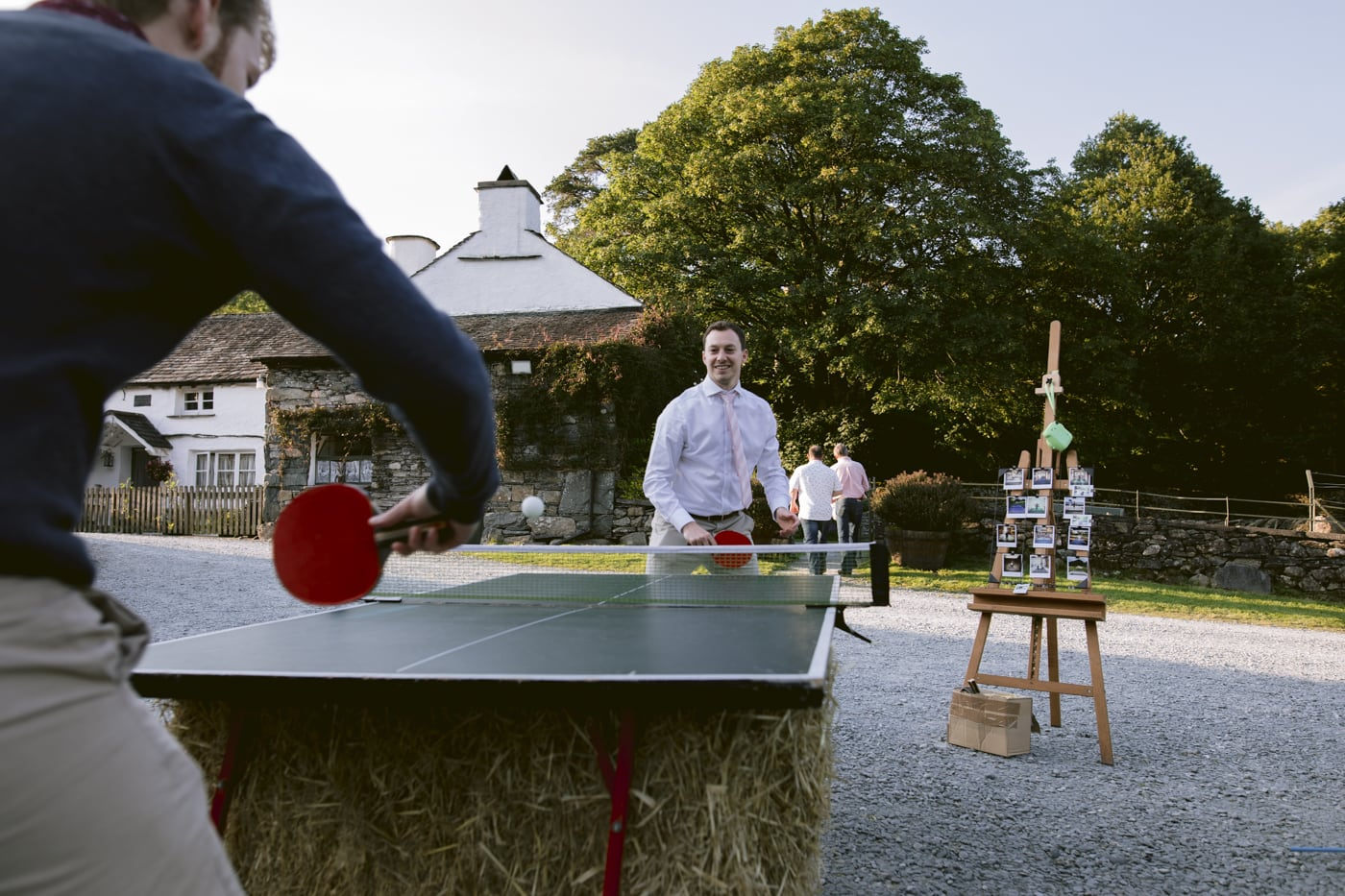 Guests outside Portrait Shot Playing Table Tennis Outside