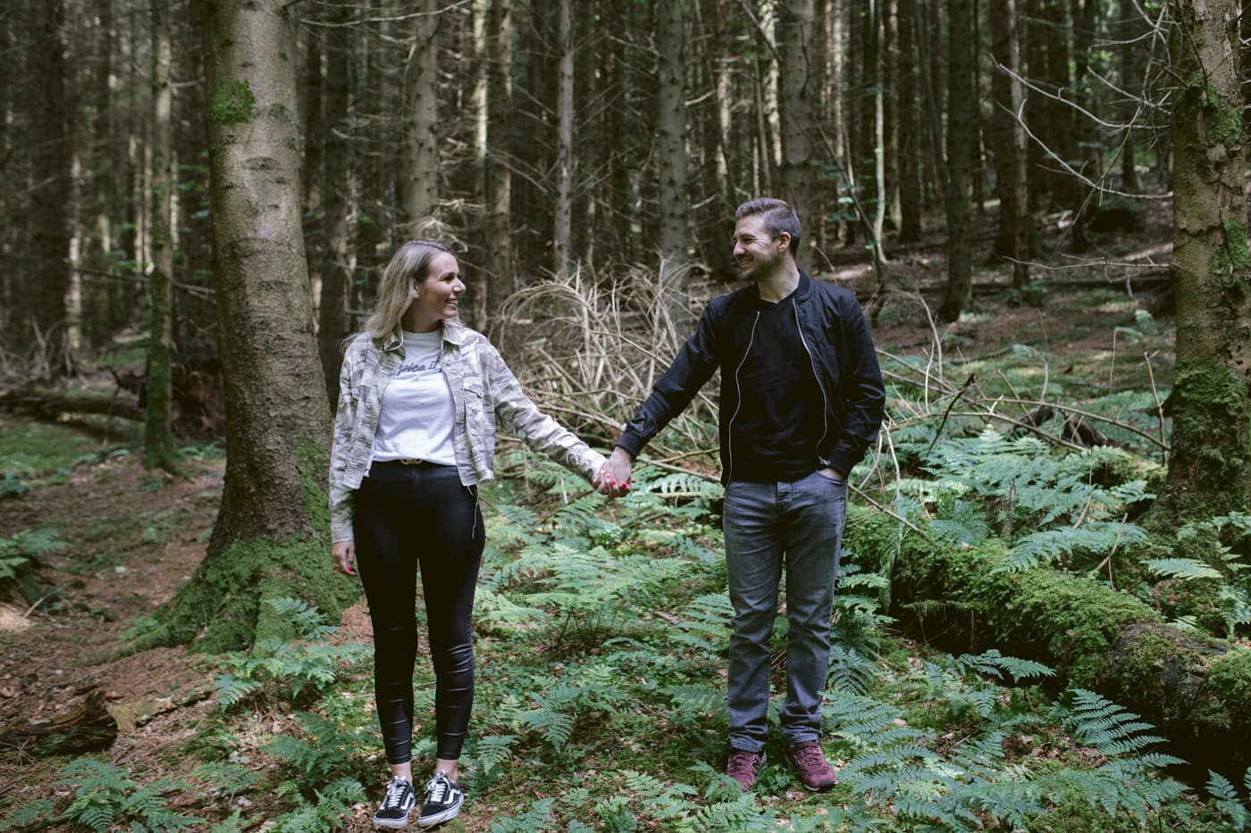 Couple Hands in Forest Gazing in Each Others Eyes Photo Portrait Shoot