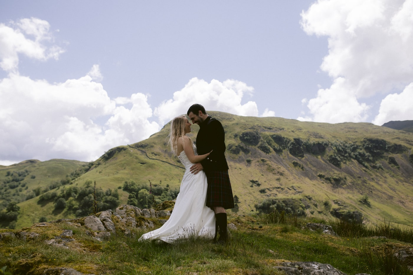 In Arms Bride and Groom with Hills in the Distance Portrait Session
