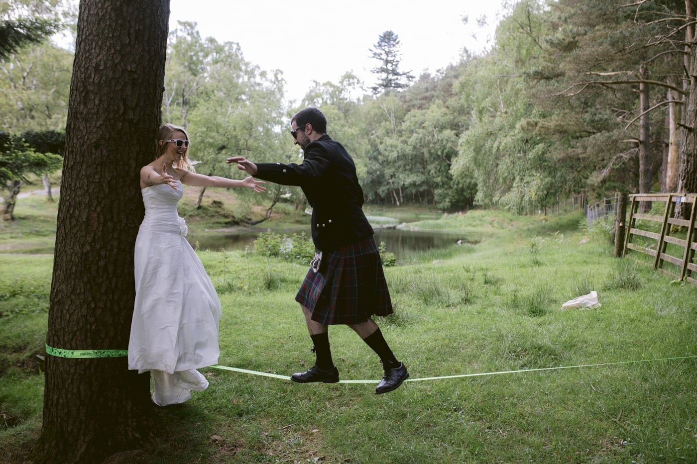 Bride and Groom Rope Walking near Open Lake Photographic Session
