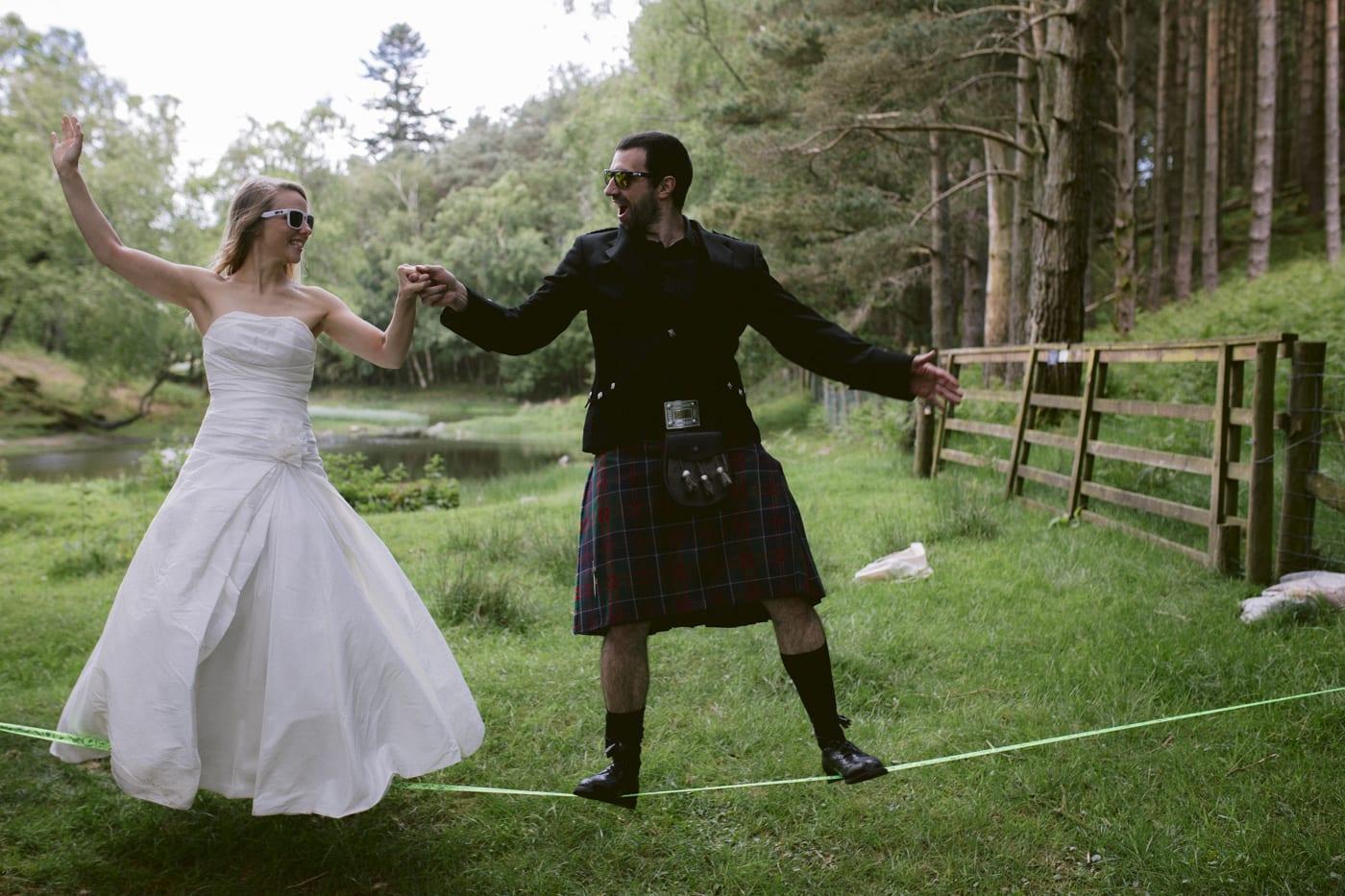 Hand in Hand Bride and Groom Rope Walking in Field Portrait Shot