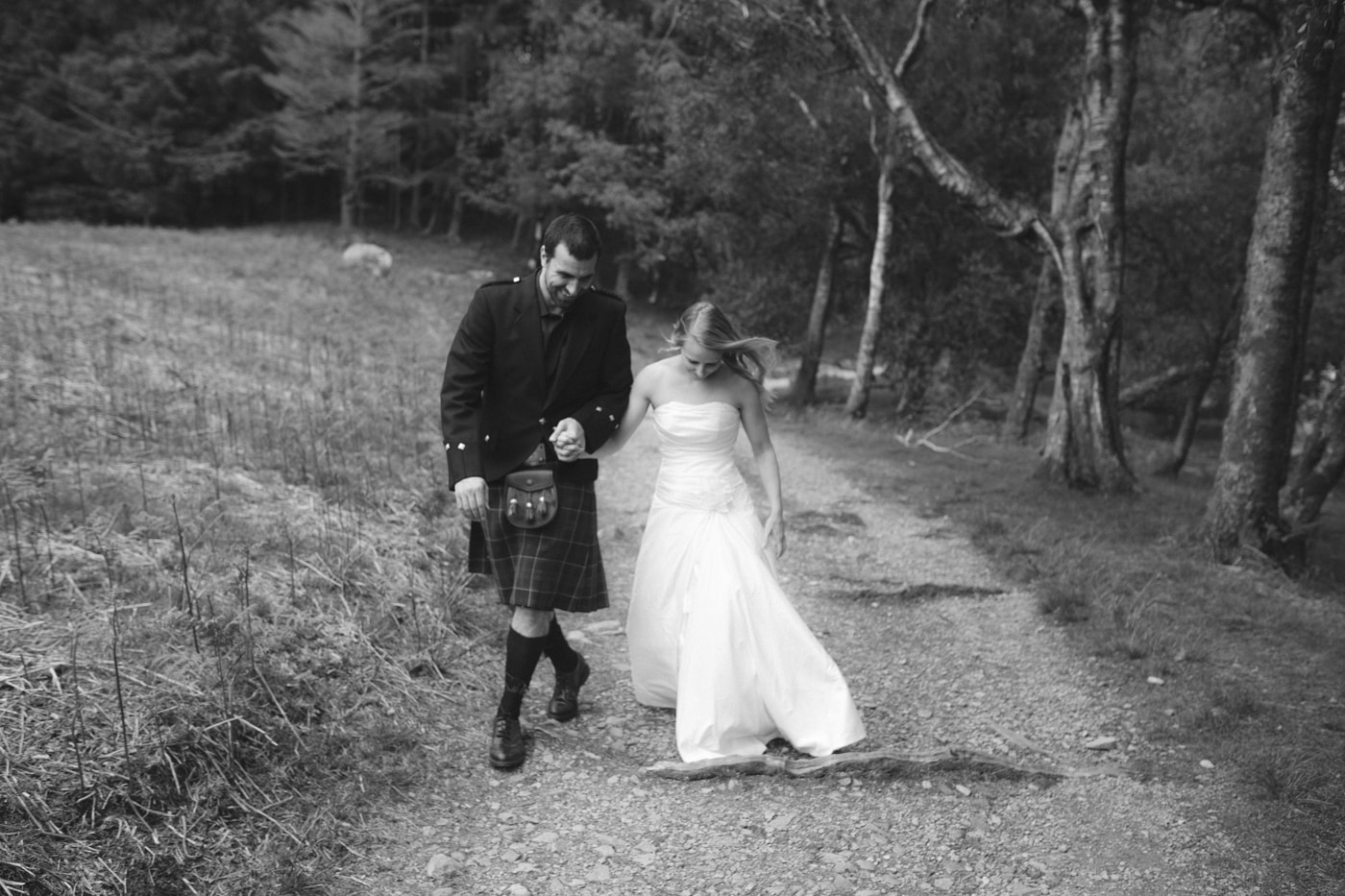 Bride and Groom Walking Down Forest Path Photo Portrait Session