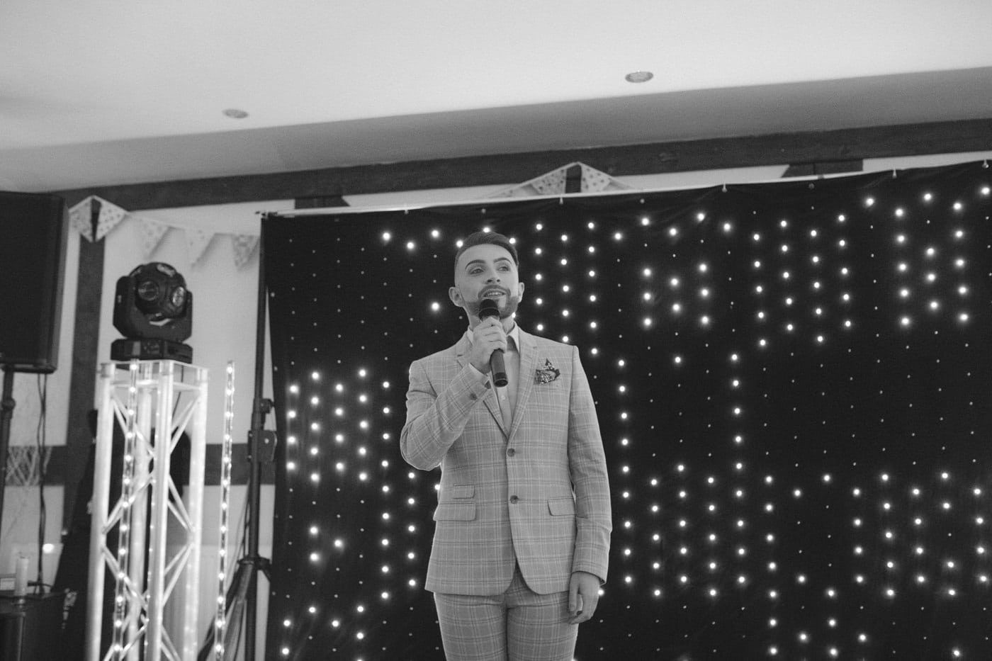 Reception Stage Guest Singing In Front of Other Guests Portrait Photography