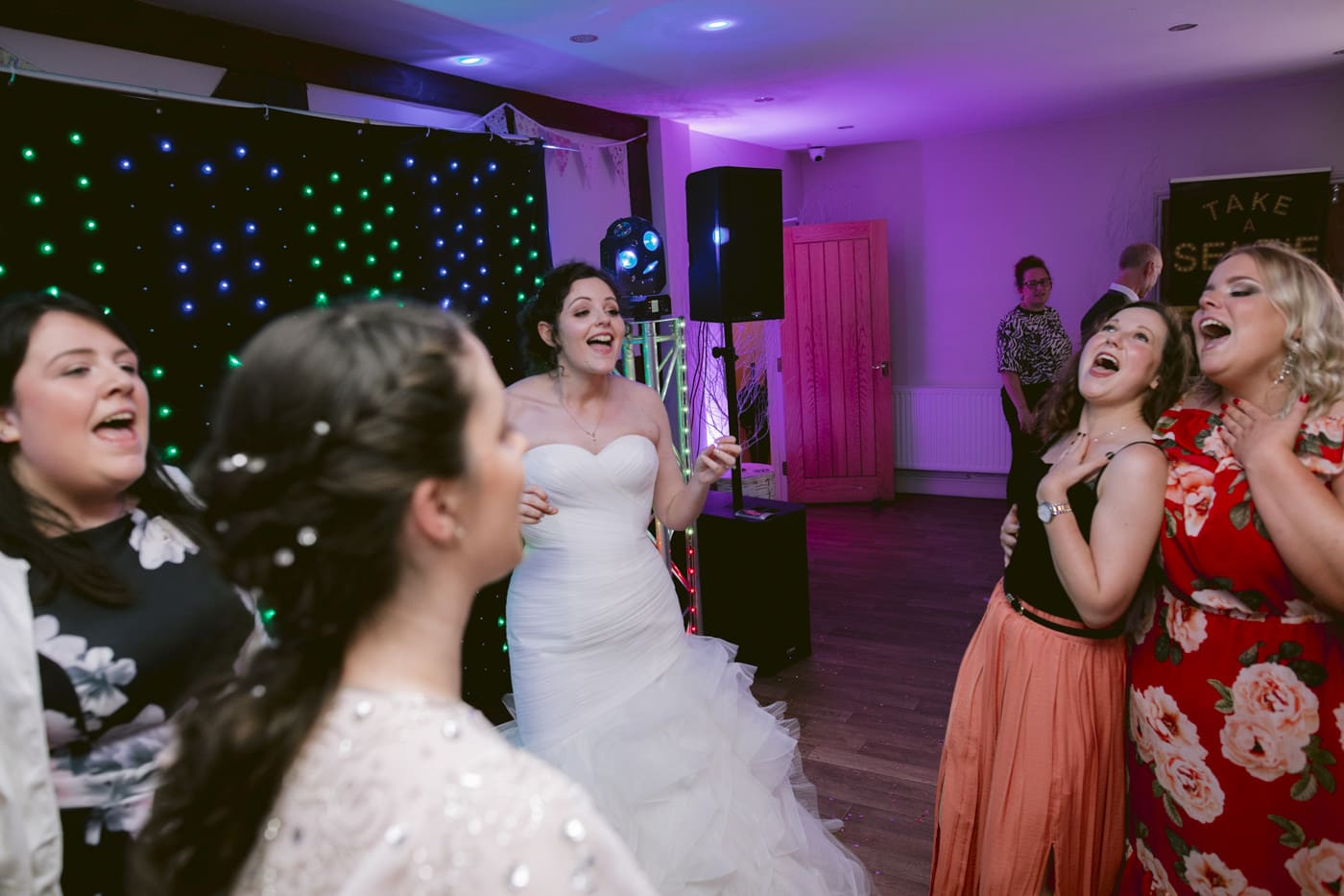 Bride and women Guests Dancing Along Portrait