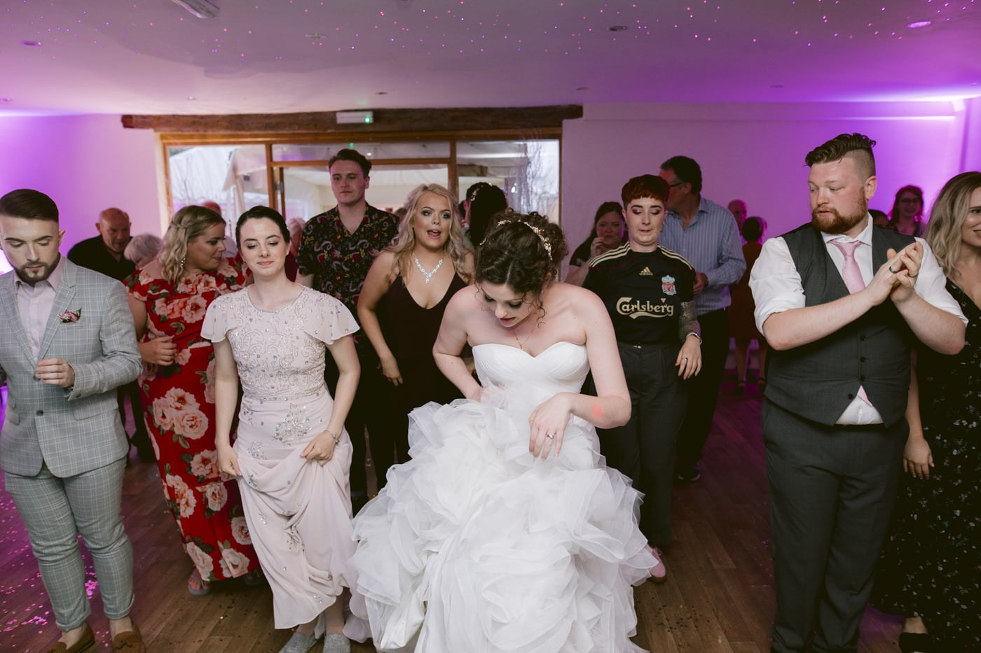 Bride Leading The Dance on The Main Floor Portrait with Guests