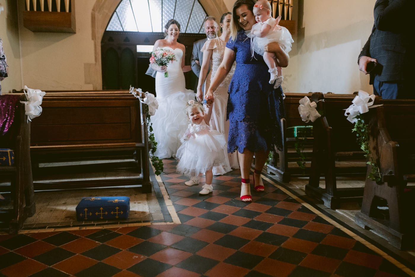 Bride and Bridesmaids walking down the Aisle Photography Session in Main Church Hall