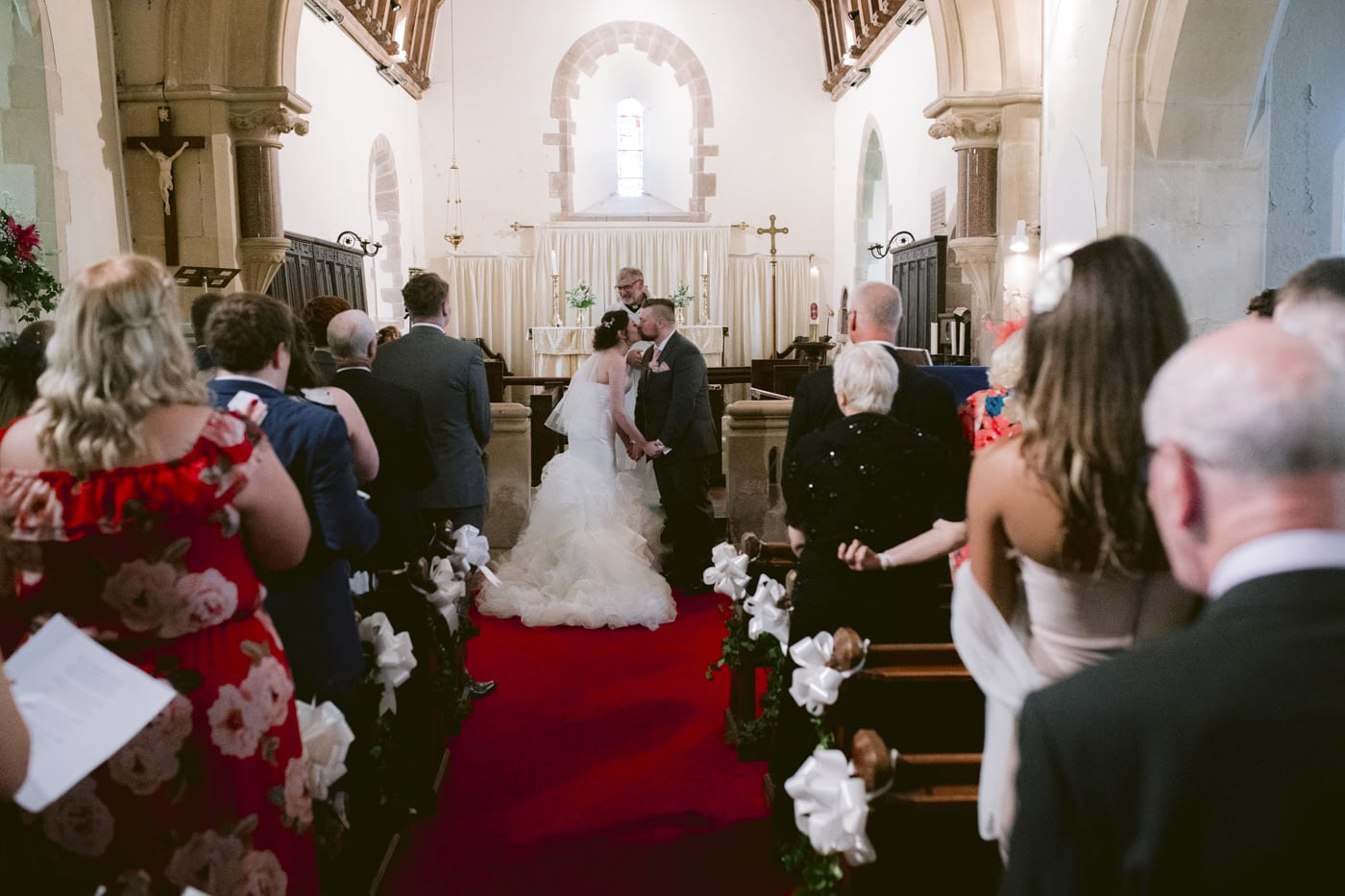 Guests and Bride and Groom Standing in Main Church Wedding Hall Portrait