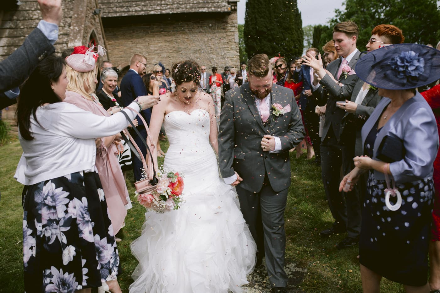 Bride and Groom Walking, Guests Celebrations outside Portrait