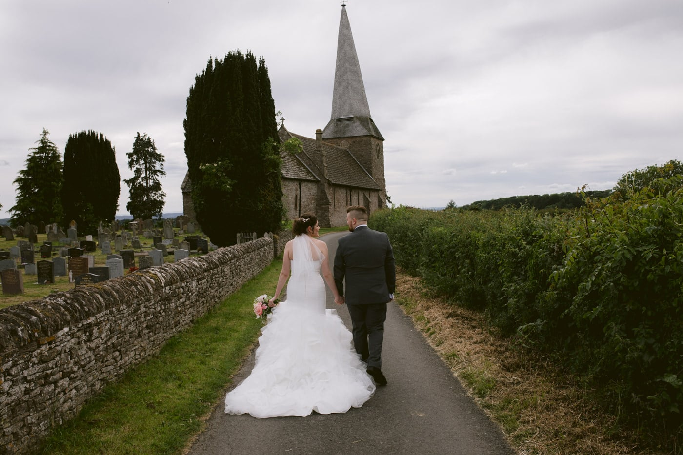Bride and Groom Walking down the Church Lane Hand in Hand Portrait Photography Session