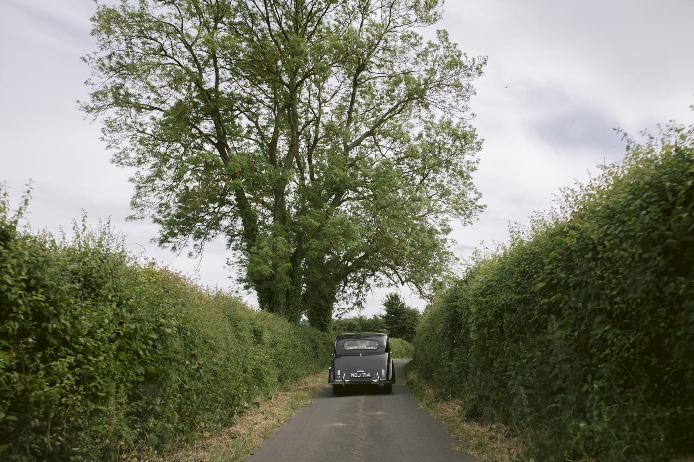 Wedding Car down the Road Distance Photography Shooting