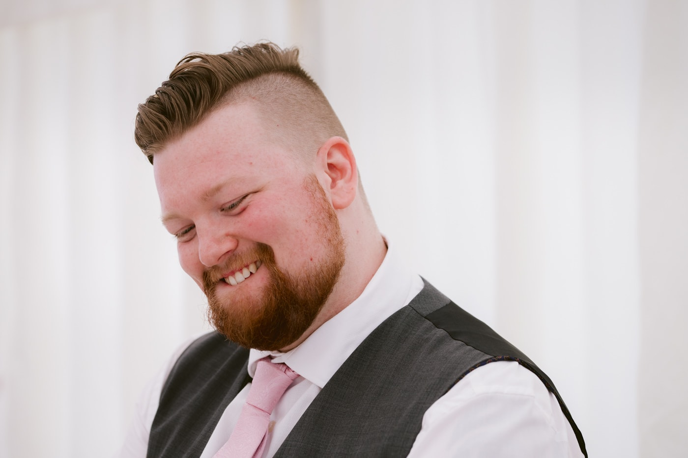 Groom Smiling at Wedding Speeches Single Portrait