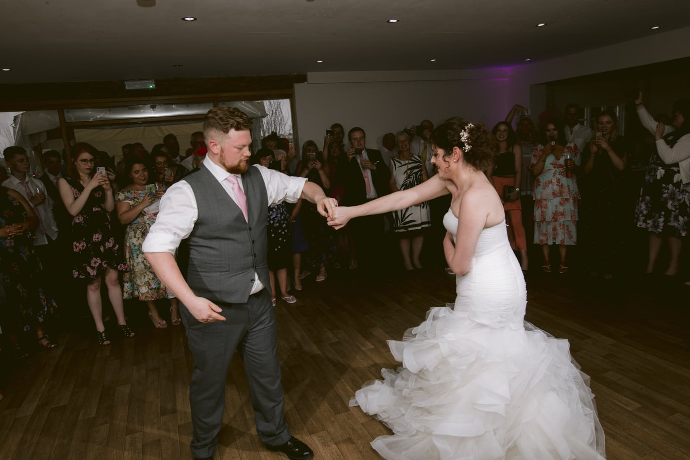 Bride and Groom Dance Twist Photograph