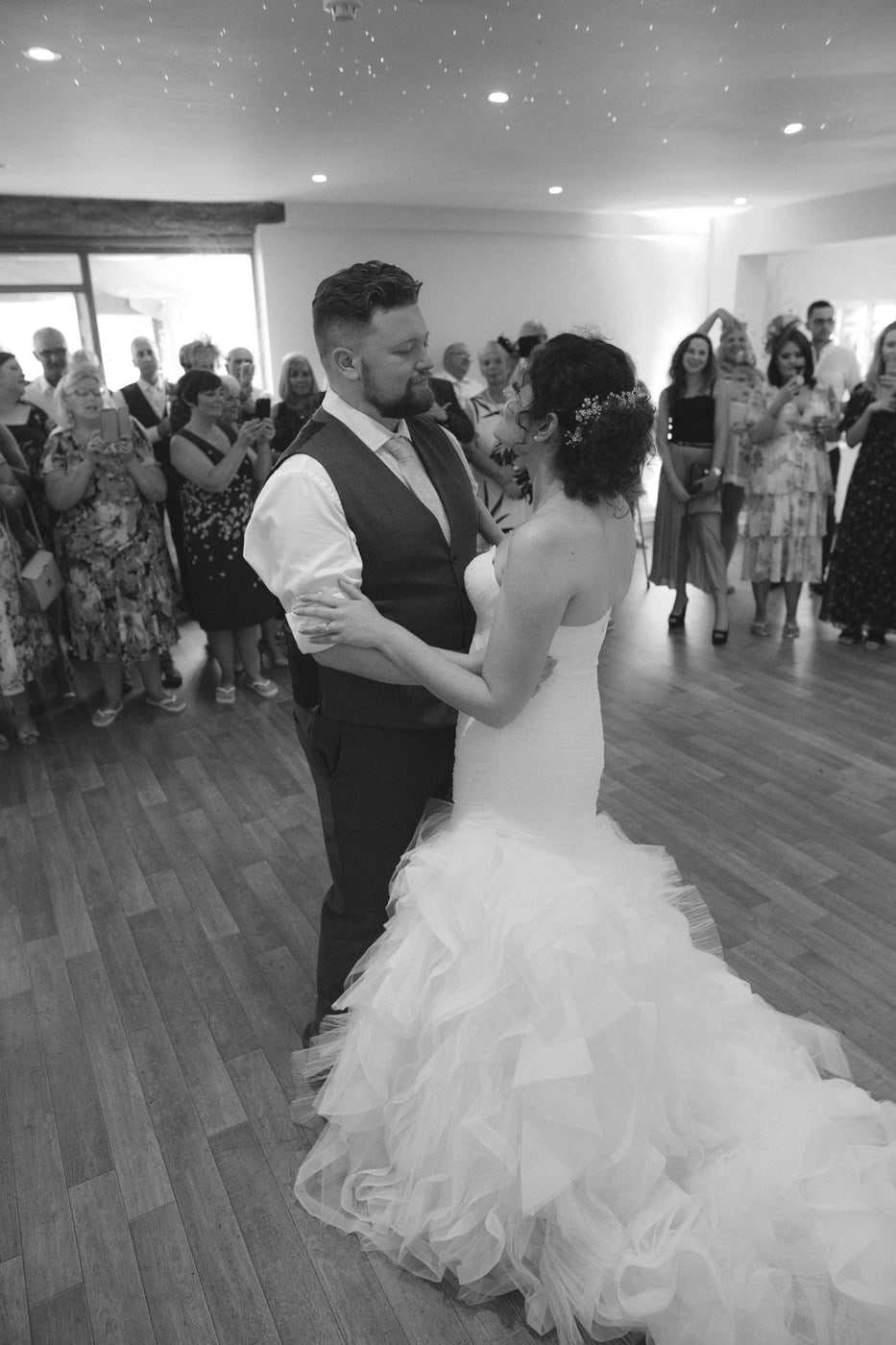 Bride and Groom Slow Dance on Main Hall Floor Photograph