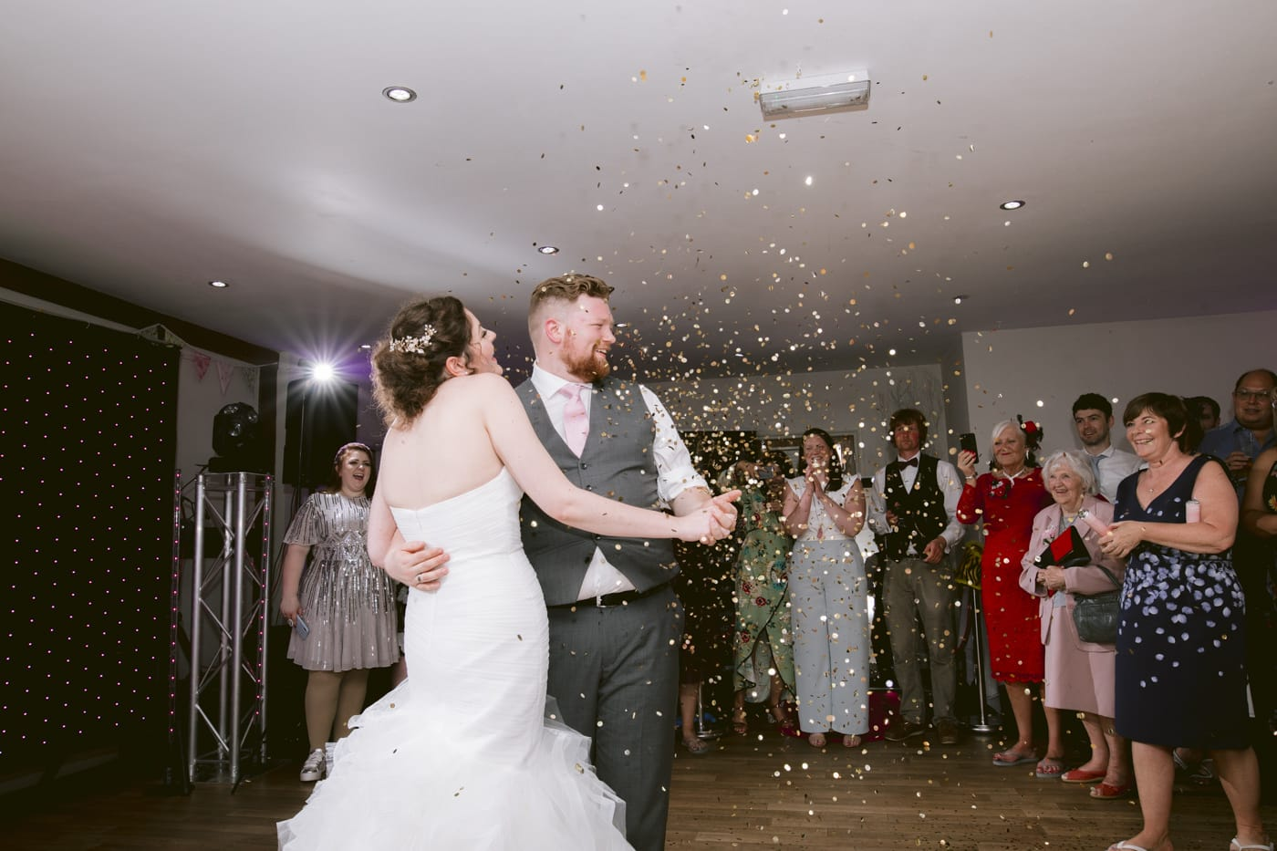 Russell and Jordan Dancing with Confetti in Main Reception Room