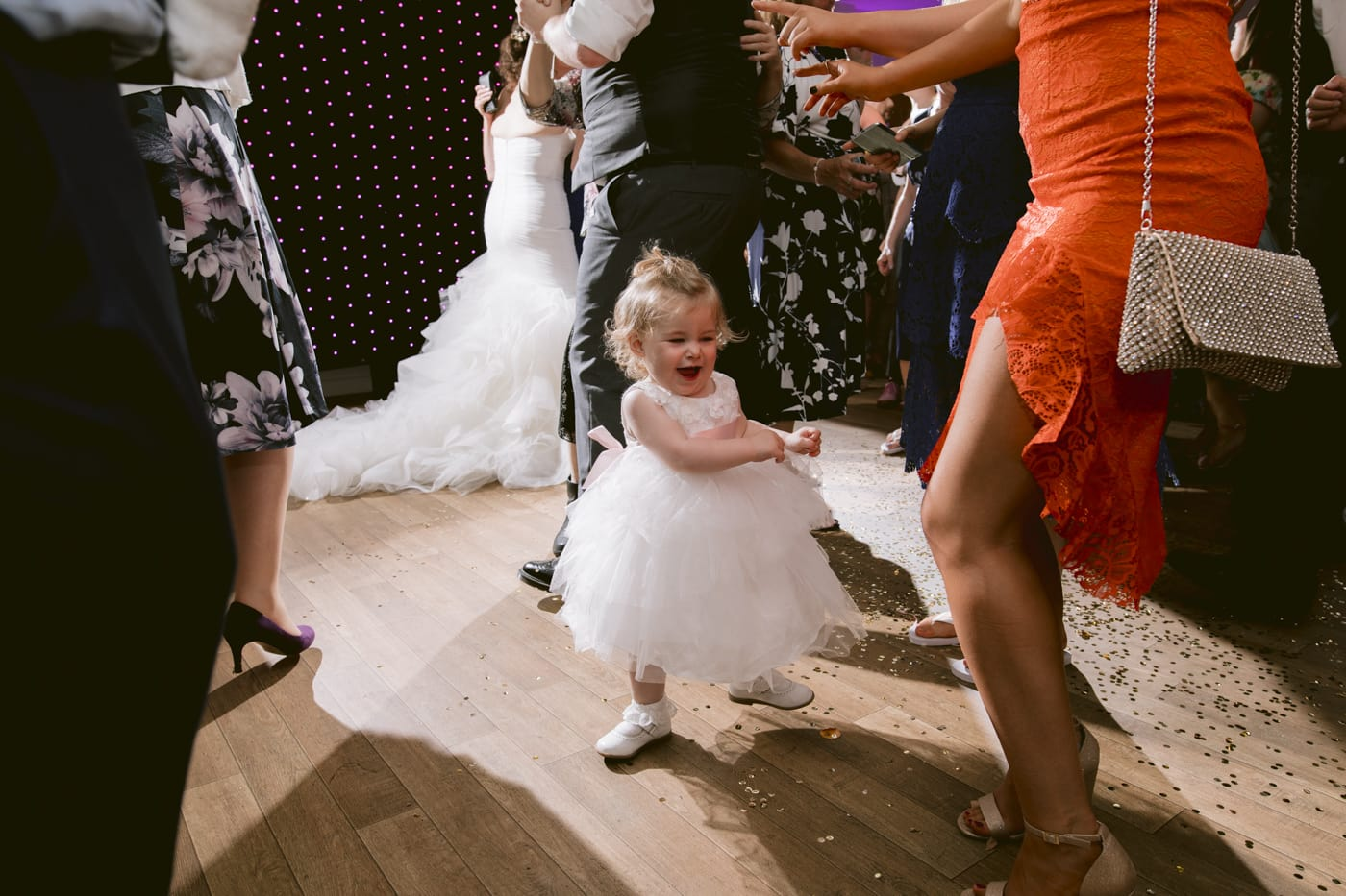 Little Bridesmaid Dancing at The Reception Portrait