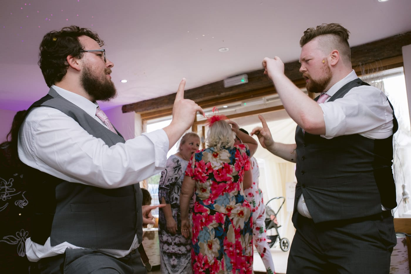 Groom and Guest Dancing Together Portrait
