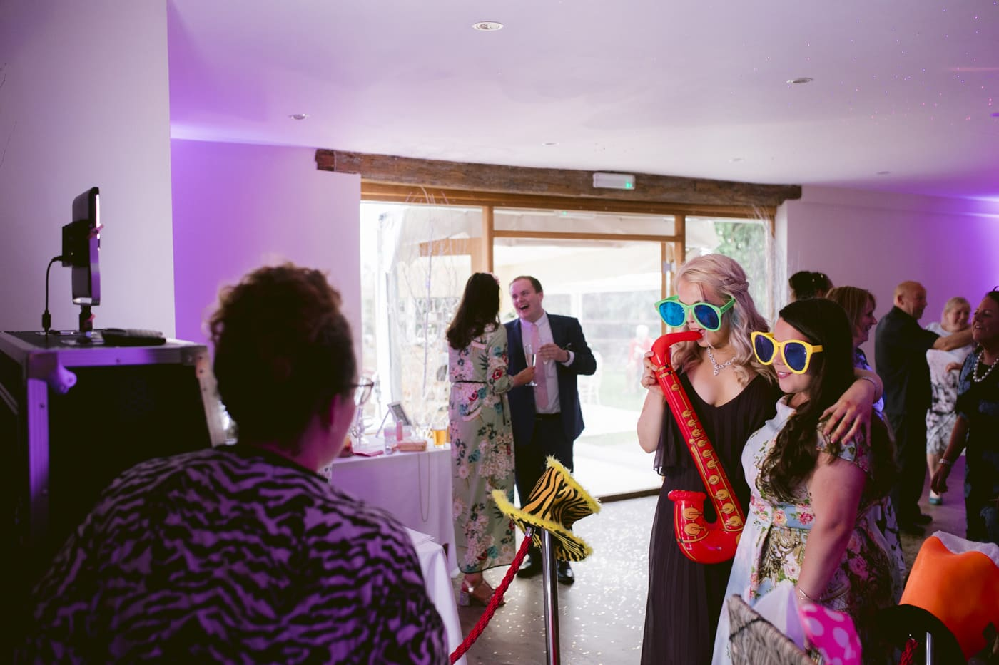 Guests wearing Sunglasses and Playing Trumpets Photograph