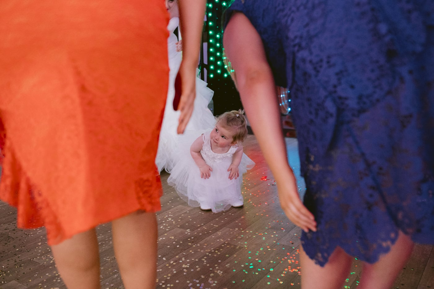 Little Bridesmaid Between Guests Dancing Portrait