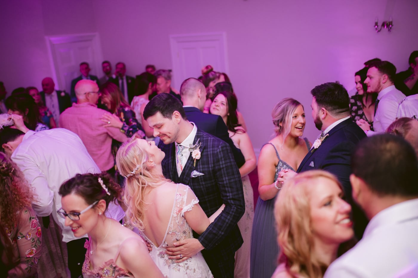 Bride and Groom Together with Guests, Happy Dancing at Storrs Hall Wedding