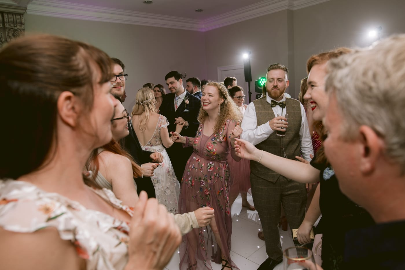 Guests on the Dance Floor Together at Storrs Hall Wedding