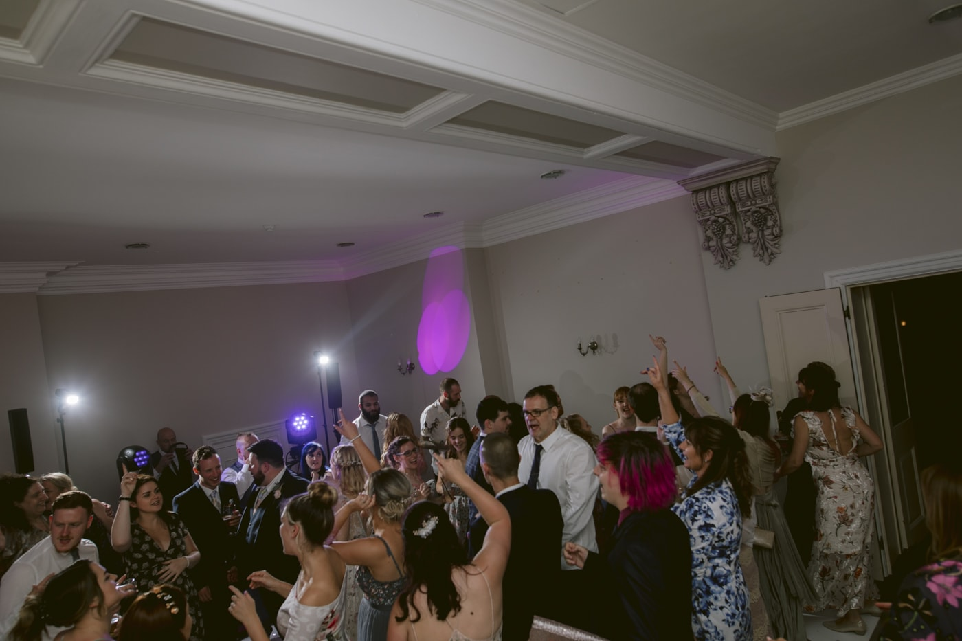 Guests and Families Together Cheering and Dancing at Storrs Hall Wedding