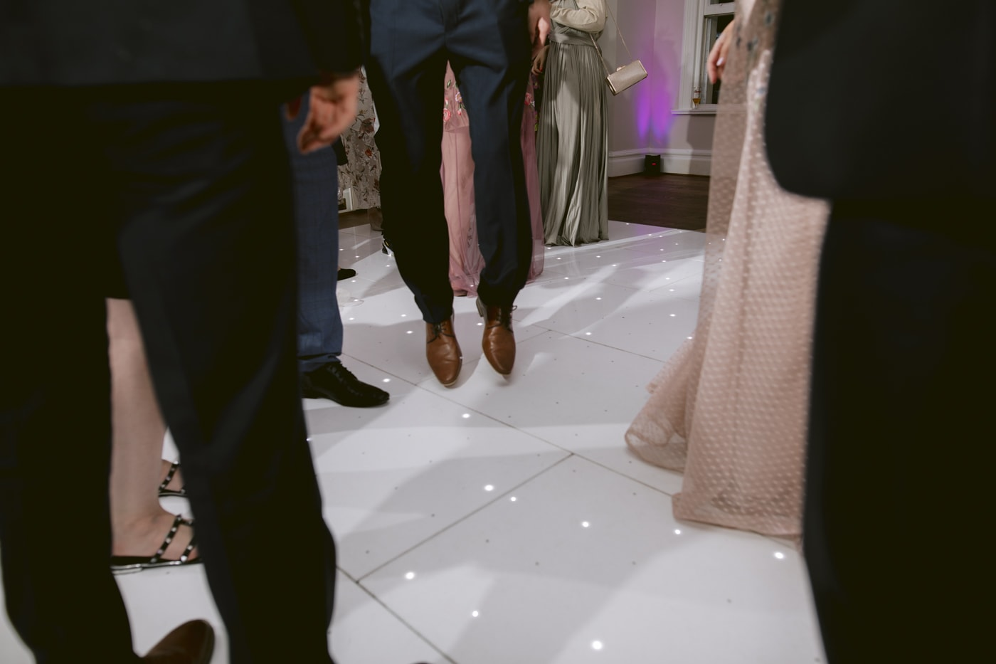 Guests Happy Feet Dancing Together at Storrs Hall Wedding
