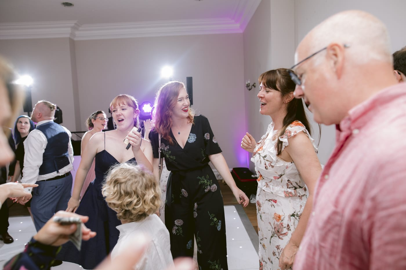 Women Guests Happy Smiling and Dancing in Main Hall at Storrs Hall Wedding