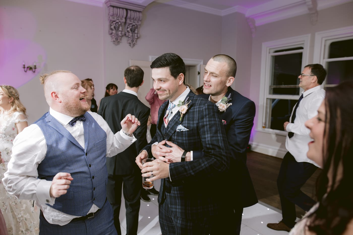 Groom and Guests Hugging Together at Storrs Hall Wedding