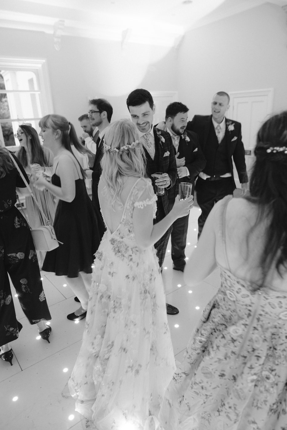 Guests, Bride and Groom Together Dancing at Storrs Hall Wedding
