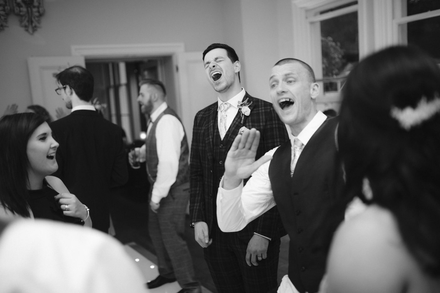 Guests and Groom Laughing at Storrs Hall Wedding