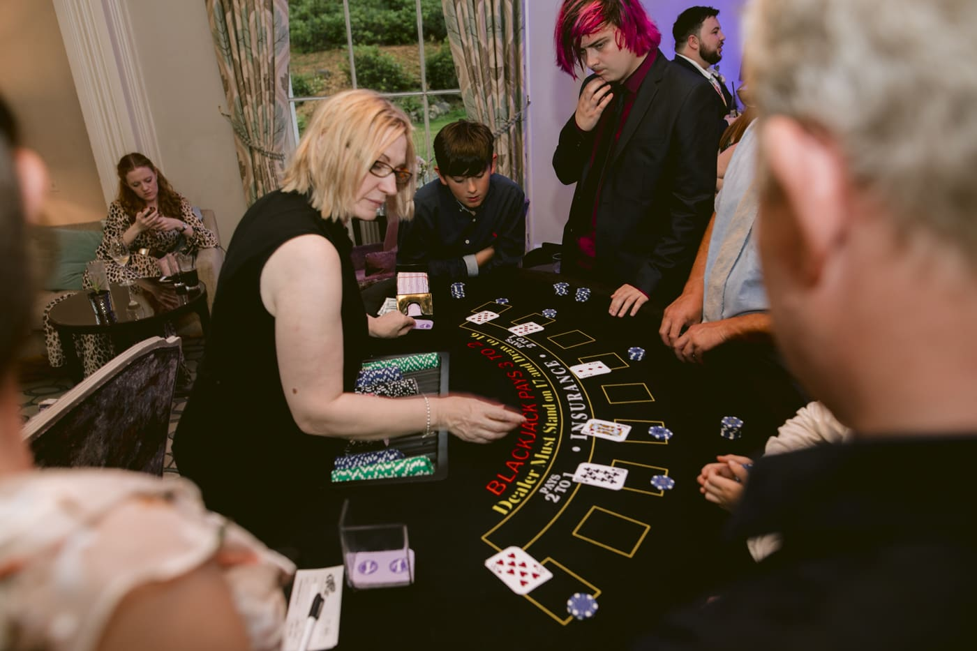 Dealer at Casino Table Dealing Cards for Guests at Storrs Hall Wedding