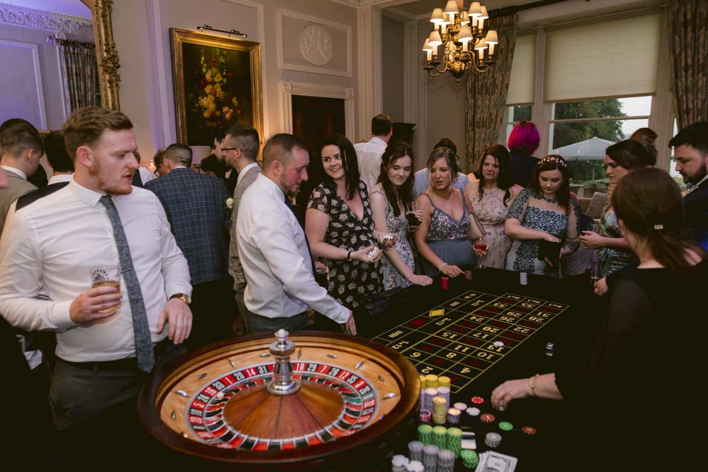 Guests and Family at Casino Having Fun at Storrs Hall Wedding