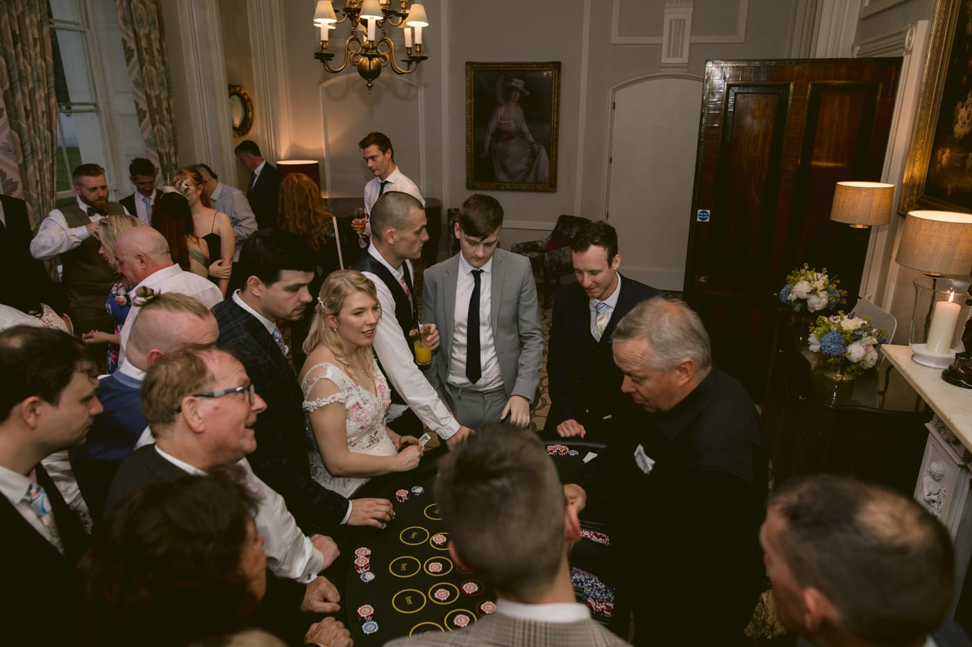 Bride and Groom Playing Casino with Guests at Storrs Hall Wedding