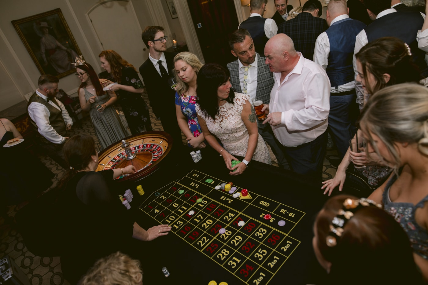Guests at Dealing Table Playing Casino at Storrs Hall Wedding