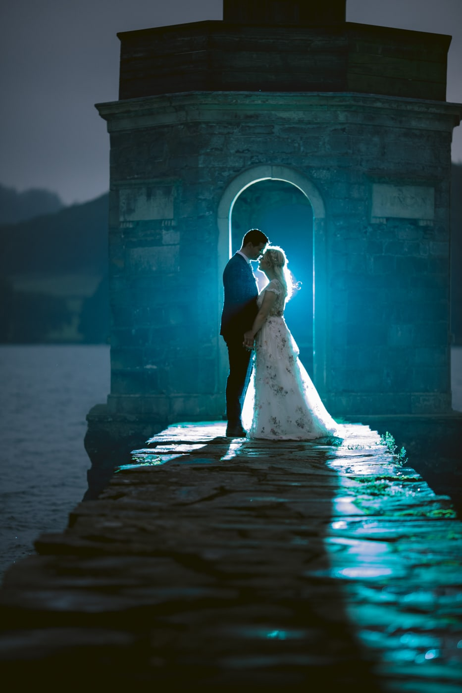 Bride and Groom Bathed in Light on Lakeside at Storrs Hall Wedding