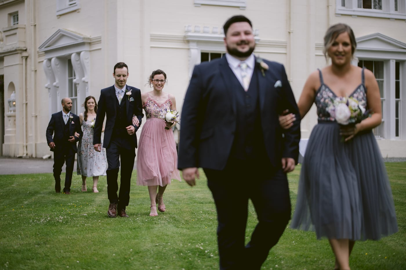 Guests walking Down to be Seated Outside Portrait Shoot at Storrs Hall Wedding